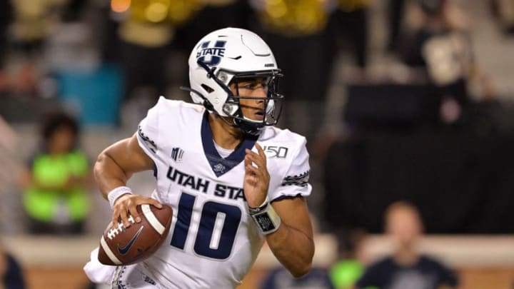 WINSTON SALEM, NORTH CAROLINA - AUGUST 30: Jordan Love #10 of the Utah State Aggies rolls out against the Wake Forest Demon Deacons during the second half of their game at BB&T Field on August 30, 2019 in Winston Salem, North Carolina. Wake Forest won 38-35. (Photo by Grant Halverson/Getty Images)
