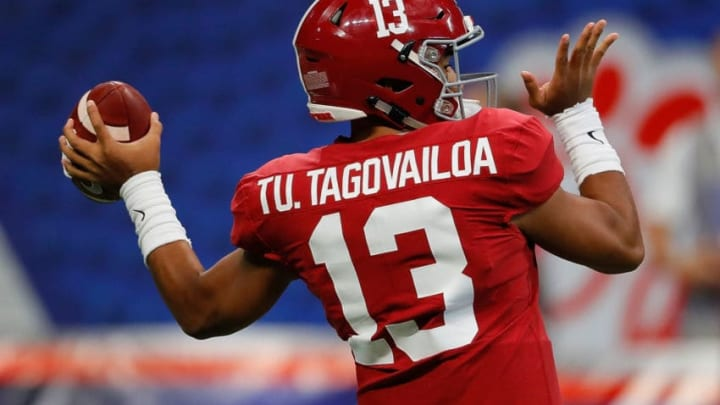 ATLANTA, GEORGIA - AUGUST 31: Tua Tagovailoa #13 of the Alabama Crimson Tide warms up prior to facing the Duke Blue Devils at Mercedes-Benz Stadium on August 31, 2019 in Atlanta, Georgia. (Photo by Kevin C. Cox/Getty Images)