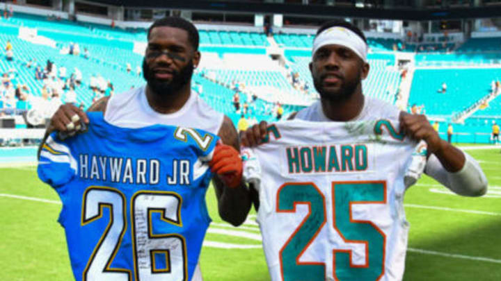 MIAMI, FL – SEPTEMBER 29: Xavien Howard #25 of the Miami Dolphins and Casey Hayward #26 of the Los Angeles Chargers trade jerseys after the game at Hard Rock Stadium on September 29, 2019, in Miami, Florida. (Photo by Eric Espada/Getty Images)