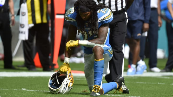 MIAMI, FL – SEPTEMBER 29: Rayshawn Jenkins #23 of the Los Angeles Chargers takes a knee while team trainers attend to Denzel Perryman #52 (not pictured) during the third quarter against the Miami Dolphins at Hard Rock Stadium on September 29, 2019, in Miami, Florida. (Photo by Eric Espada/Getty Images)