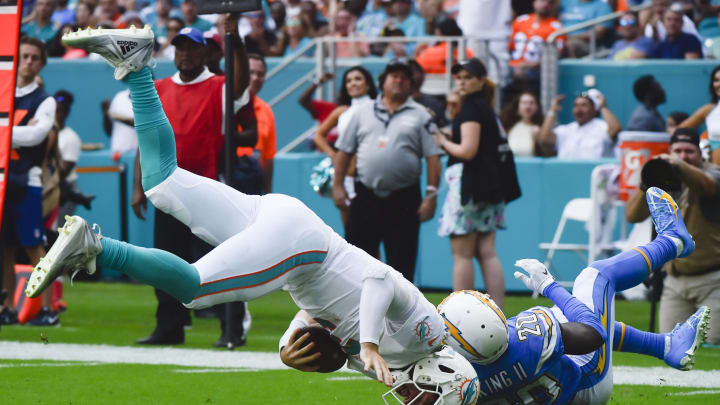 MIAMI, FL – SEPTEMBER 29: Desmond King #20 of the Los Angeles Chargers tackles Josh Rosen #3 of the Miami Dolphins during the third quarter of the game at Hard Rock Stadium on September 29, 2019, in Miami, Florida. (Photo by Eric Espada/Getty Images)