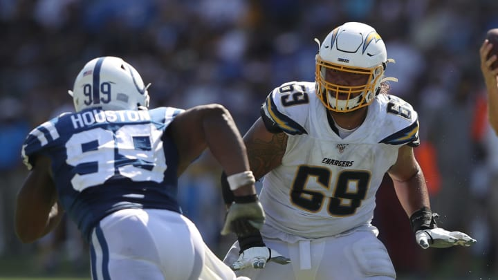 CARSON, CALIFORNIA – SEPTEMBER 08: Sam Tevi #69 of the Los Angeles Chargers blocks Justin Houston #99 of the Indianapolis Colts during the second half of a game at Dignity Health Sports Park on September 08, 2019 in Carson, California. (Photo by Sean M. Haffey/Getty Images)