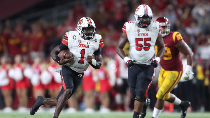 LOS ANGELES, CALIFORNIA – SEPTEMBER 20: Quarterback Tyler Huntley #1 of the Utah Utes runs for a first down against the USC Trojans in the second quarter at Los Angeles Memorial Coliseum on September 20, 2019 in Los Angeles, California. (Photo by Meg Oliphant/Getty Images)