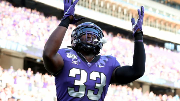 FORT WORTH, TEXAS - SEPTEMBER 21: Sewo Olonilua #33 of the TCU Horned Frogs celebrates after scoring a touchdown against the Southern Methodist Mustangs in the second half at Amon G. Carter Stadium on September 21, 2019 in Fort Worth, Texas. (Photo by Tom Pennington/Getty Images)