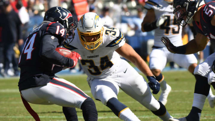CARSON, CALIFORNIA - SEPTEMBER 22: Fullback Derek Watt #34 of the Los Angeles Chargers attempts to tackle wide receiver DeAndre Carter #14 of the Houston Texans at Dignity Health Sports Park on September 22, 2019 in Carson, California. (Photo by Meg Oliphant/Getty Images)