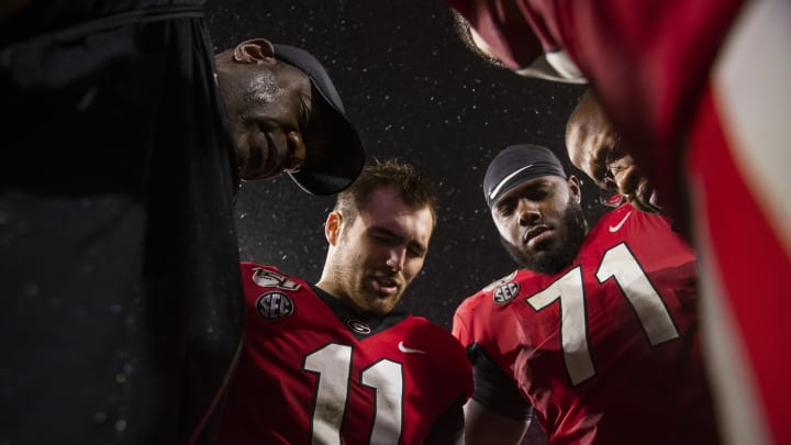 ATHENS, GA – OCTOBER 19: Bryant Gantt, Jake Fromm #11, and Andrew Thomas #71 of the Georgia Bulldogs pray following the game against the Kentucky Wildcats at Sanford Stadium on October 19, 2019, in Athens, Georgia. (Photo by Carmen Mandato/Getty Images)