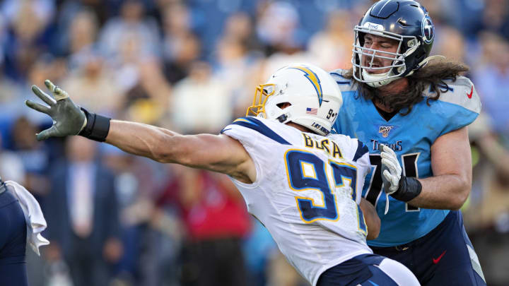 NASHVILLE, TN – OCTOBER 20: Joey Bosa #97 of the Los Angeles Chargers rushes the quarterback and is blocked by Dennis Kelly #71 of the Tennessee Titans at Nissan Stadium on October 20, 2019 in Nashville, Tennessee. The Titans defeated the Chargers 23-20. (Photo by Wesley Hitt/Getty Images)