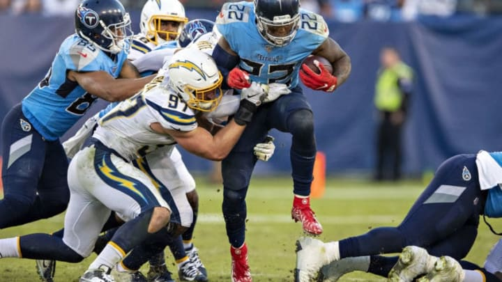 NASHVILLE, TN - OCTOBER 20: Derrick Henry #22 of the Tennessee Titans runs the ball up the middle and is tackled by Joey Bosa #97 of the Los Angeles Chargers at Nissan Stadium on October 20, 2019 in Nashville, Tennessee. The Titans defeated the Chargers 23-20. (Photo by Wesley Hitt/Getty Images)