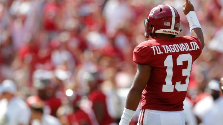 TUSCALOOSA, ALABAMA - SEPTEMBER 28: Tua Tagovailoa #13 of the Alabama Crimson Tide reacts after passing for a touchdown against the Mississippi Rebels at Bryant-Denny Stadium on September 28, 2019 in Tuscaloosa, Alabama. (Photo by Kevin C. Cox/Getty Images)