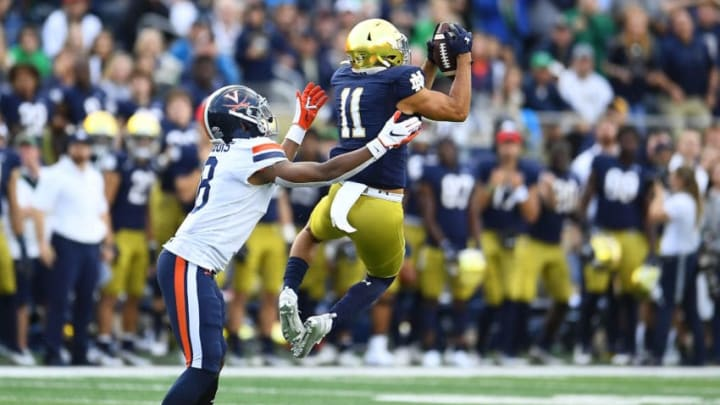 SOUTH BEND, INDIANA - SEPTEMBER 28: Alohi Gilman #11 of the Notre Dame Fighting Irish intercepts a pass intended for Hasise Dubois #8 of the Virginia Cavaliers during the second half at Notre Dame Stadium on September 28, 2019 in South Bend, Indiana. (Photo by Stacy Revere/Getty Images)