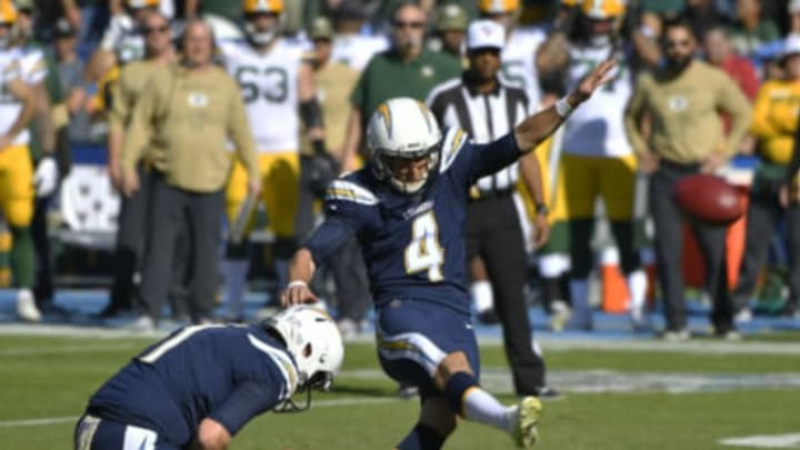 CARSON, CA – NOVEMBER 03: Ty Long #1 of the Los Angeles Chargers holds the ball as Mike Badgley #4 kicks a field goal for the first score of the game against the Green Bay Packers at Dignity Health Sports Park on November 3, 2019, in Carson, California. (Photo by John McCoy/Getty Images)