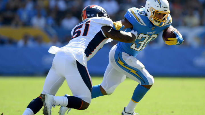 CARSON, CALIFORNIA – OCTOBER 06: Austin Ekeler #30 of the Los Angeles Chargers runs after his catch as he is chased by Todd Davis #51 of the Denver Broncos during the second quarter at Dignity Health Sports Park on October 06, 2019 in Carson, California. (Photo by Harry How/Getty Images)