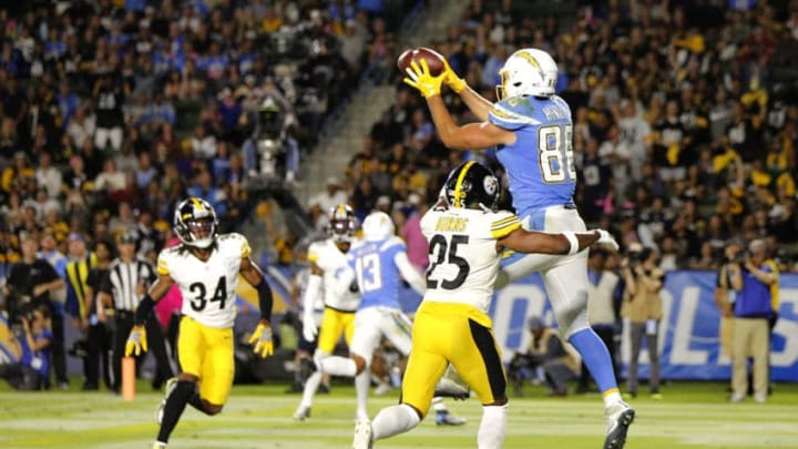 CARSON, CALIFORNIA - OCTOBER 13: Tight end Hunter Henry #86 of the Los Angeles Chargers makes the catch for a touchdown as cornerback Joe Haden #23 of the Pittsburgh Steelers defends during the fourth quarter at Dignity Health Sports Park on October 13, 2019 in Carson, California. (Photo by Katharine Lotze/Getty Images)