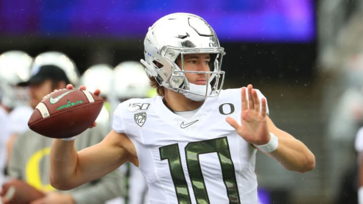 SEATTLE, WASHINGTON - OCTOBER 19: Justin Herbert #10 of the Oregon Ducks warms up prior to taking on the Washington Huskies during their game at Husky Stadium on October 19, 2019 in Seattle, Washington. (Photo by Abbie Parr/Getty Images)
