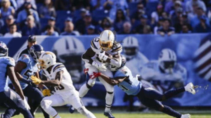NASHVILLE, TENNESSEE – OCTOBER 20: Melvin Gordon III #25 of the Log Angeles Chargers is tackled while running with the ball during the first quarter by Malcolm Butler #21 of the Tennessee Titans at Nissan Stadium on October 20, 2019 in Nashville, Tennessee. (Photo by Silas Walker/Getty Images)