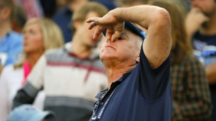 NASHVILLE, TENNESSEE – OCTOBER 20: A fan of the Tennessee Titans holds his nose after a call against the Los Angeles Chargers was reversed during the second half at Nissan Stadium on October 20, 2019 in Nashville, Tennessee. (Photo by Frederick Breedon/Getty Images)
