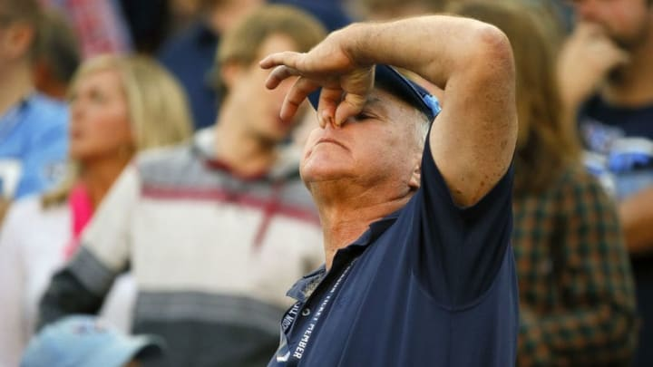 NASHVILLE, TENNESSEE - OCTOBER 20: A fan of the Tennessee Titans holds his nose after a call against the Los Angeles Chargers was reversed during the second half at Nissan Stadium on October 20, 2019 in Nashville, Tennessee. (Photo by Frederick Breedon/Getty Images)