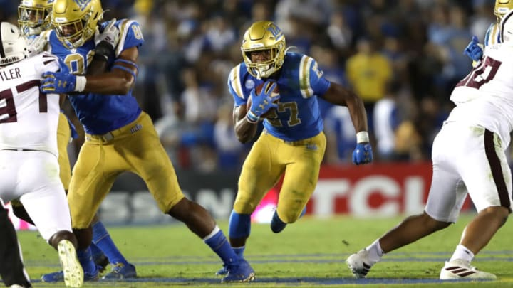 LOS ANGELES, CALIFORNIA - OCTOBER 26: Joshua Kelley #27 of the UCLA Bruins breaks free on a run play during the second half of a game against the Arizona State Sun Devils on October 26, 2019 in Los Angeles, California. (Photo by Sean M. Haffey/Getty Images)