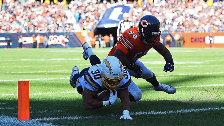 CHICAGO, ILLINOIS – OCTOBER 27: Austin Ekeler #30 of the Los Angeles Chargers dives for a touchdown in front of Roquan Smith #58 of the Chicago Bears during the second half of a game at Soldier Field on October 27, 2019, in Chicago, Illinois. (Photo by Stacy Revere/Getty Images)