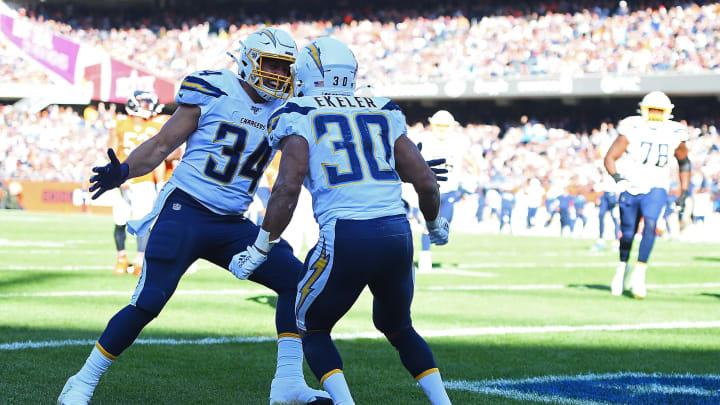 CHICAGO, ILLINOIS – OCTOBER 27: Austin Ekeler #30 of the Los Angeles Chargers celebrates with Derek Watt #34 after scoring a touchdown during the second half of a game against the Chicago Bears at Soldier Field on October 27, 2019 in Chicago, Illinois. (Photo by Stacy Revere/Getty Images)