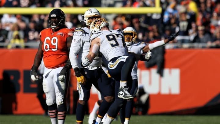 CHICAGO, ILLINOIS – OCTOBER 27: Joey Bosa #97 of the Los Angeles Chargers celebrates after making a sack in the fourth quarter against the Chicago Bears at Soldier Field on October 27, 2019 in Chicago, Illinois. (Photo by Dylan Buell/Getty Images)