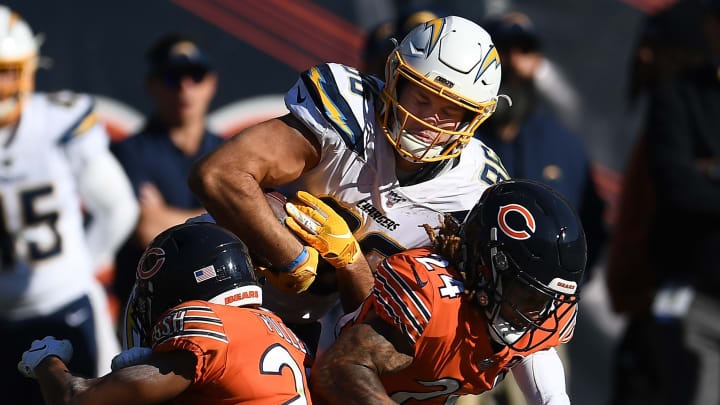 CHICAGO, ILLINOIS – OCTOBER 27: Hunter Henry #86 of the Los Angeles Chargers is brought down by Buster Skrine #24 and Kyle Fuller #23 of the Chicago Bears during the second half of a game at Soldier Field on October 27, 2019, in Chicago, Illinois. (Photo by Stacy Revere/Getty Images)