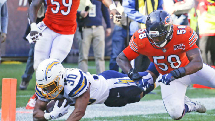 CHICAGO, ILLINOIS - OCTOBER 27: Austin Ekeler #30 of the Los Angeles Chargers scores a touchdown in front of Roquan Smith #58 of the Chicago Bears during the second half at Soldier Field on October 27, 2019 in Chicago, Illinois. (Photo by Nuccio DiNuzzo/Getty Images)