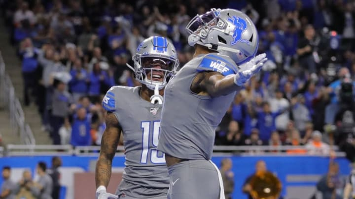 DETROIT, MI - NOVEMBER 28: Marvin Jones #11 of the Detroit Lions celebrates a first quarter touchdown with teammate Kenny Golladay #19 during the first quarter of the game against the Chicago Bears at Ford Field on November 28, 2019 in Detroit, Michigan. (Photo by Leon Halip/Getty Images)