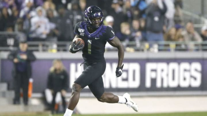 FORT WORTH, TX - NOVEMBER 29: Jalen Reagor #1 of the TCU Horned Frogs returns a punt for a touchdown against the West Virginia Mountaineers in the second half at Amon G. Carter Stadium on November 29, 2019 in Fort Worth, Texas. West Virginia won 20-17. (Photo by Ron Jenkins/Getty Images)