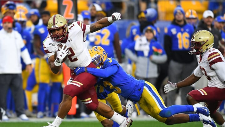 PITTSBURGH, PA – NOVEMBER 30: AJ Dillon #2 of the Boston College Eagles gets tackled by Damar Hamlin #3 of the Pittsburgh Panthers during the first quarter at Heinz Field on November 30, 2019, in Pittsburgh, Pennsylvania. (Photo by Joe Sargent/Getty Images)