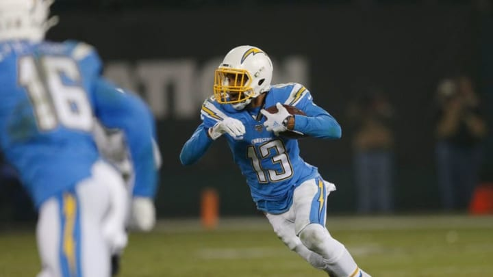 OAKLAND, CALIFORNIA - NOVEMBER 07: Keenan Allen #13 of the Los Angeles Chargers runs with the ball after making a catch in the fourth quarter against the Oakland Raiders at RingCentral Coliseum on November 07, 2019 in Oakland, California. (Photo by Lachlan Cunningham/Getty Images)