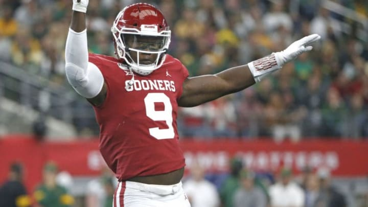 ARLINGTON, TX - DECEMBER 07: Kenneth Murray #9 of the Oklahoma Sooners celebrates after stopping the Baylor Bears offense in the first quarter of the Big 12 Football Championship at AT&T Stadium on December 7, 2019 in Arlington, Texas. (Photo by Ron Jenkins/Getty Images)