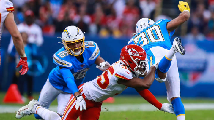 MEXICO CITY, MEXICO – NOVEMBER 18: Cornerback Charvarius Ward #35 of the Kansas City Chiefs tackles Running back Austin Ekeler #30 of Los Angeles Chargers during the first half of a match against Los Angeles Chargers at Estadio Azteca on November 18, 2019 in Mexico City, Mexico. (Photo by Manuel Velasquez/Getty Images)