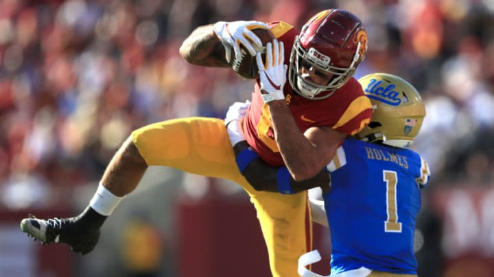LOS ANGELES, CALIFORNIA - NOVEMBER 23: Darnay Holmes #1 of the UCLA Bruins defends as Michael Pittman Jr. #6 of the USC Trojans makes a catch during the first half of a game at Los Angeles Memorial Coliseum on November 23, 2019 in Los Angeles, California. (Photo by Sean M. Haffey/Getty Images)