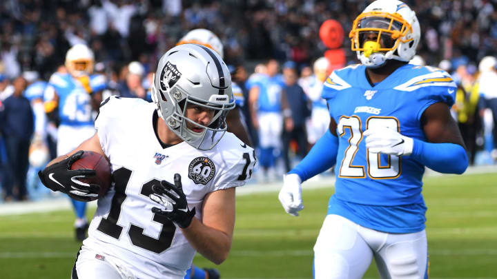 CARSON, CA – DECEMBER 22: Wide receiver Hunter Renfrow #13 of the Oakland Raiders out runs defensive back Desmond King #20 of the Los Angeles Chargers for a touch down in the first quarter of the game at Dignity Health Sports Park on December 22, 2019, in Carson, California. (Photo by Jayne Kamin-Oncea/Getty Images)