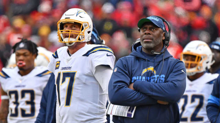 KANSAS CITY, MO - DECEMBER 29: Head coach Anthony Lynn (R) of the Los Angeles Chargers and quarterback Philip Rivers #17 look up at the replay during the second half against the Kansas City Chiefs at Arrowhead Stadium on December 29, 2019 in Kansas City, Missouri. (Photo by Peter Aiken/Getty Images)