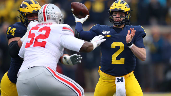 ANN ARBOR, MICHIGAN – NOVEMBER 30: Shea Patterson #2 of the Michigan Wolverines throws a first-quarter pass over Antwuan Jackson #52 of the Ohio State Buckeyes at Michigan Stadium on November 30, 2019, in Ann Arbor, Michigan. (Photo by Gregory Shamus/Getty Images)