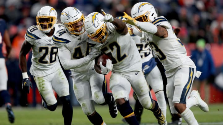 DENVER, COLORADO - DECEMBER 01: Denzel Perryman #52 of the Los Angeles Chargers celebrates with Kyzir White #44 and Derwin James #33 after making an interception against the Denver Broncos in the fourth quarter at Empower Field at Mile High on December 01, 2019 in Denver, Colorado. (Photo by Matthew Stockman/Getty Images)