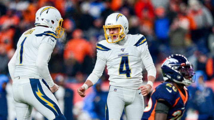 DENVER, CO - DECEMBER 1: Michael Badgley #4 of the Los Angeles Chargers celebrates with Ty Long #1 after a fourth quarter game-tying field goal against the Denver Broncos at Empower Field at Mile High on December 1, 2019 in Denver, Colorado. (Photo by Dustin Bradford/Getty Images)