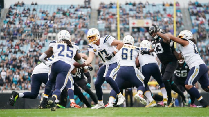 JACKSONVILLE, FLORIDA - DECEMBER 08: Philip Rivers #17 of the Los Angeles Chargers hands off the ball to Melvin Gordon #25 during the first quarter of a game against the Jacksonville Jaguars at TIAA Bank Field on December 08, 2019 in Jacksonville, Florida. (Photo by James Gilbert/Getty Images)