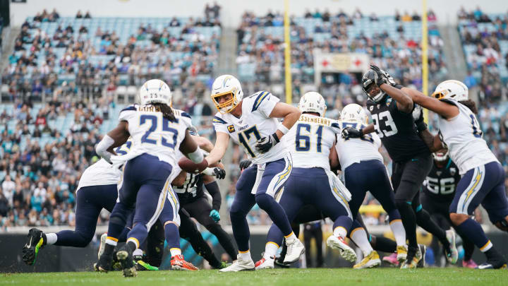 JACKSONVILLE, FLORIDA – DECEMBER 08: Philip Rivers #17 of the Los Angeles Chargers hands off the ball to Melvin Gordon #25 during the first quarter of a game against the Jacksonville Jaguars at TIAA Bank Field on December 08, 2019 in Jacksonville, Florida. (Photo by James Gilbert/Getty Images)