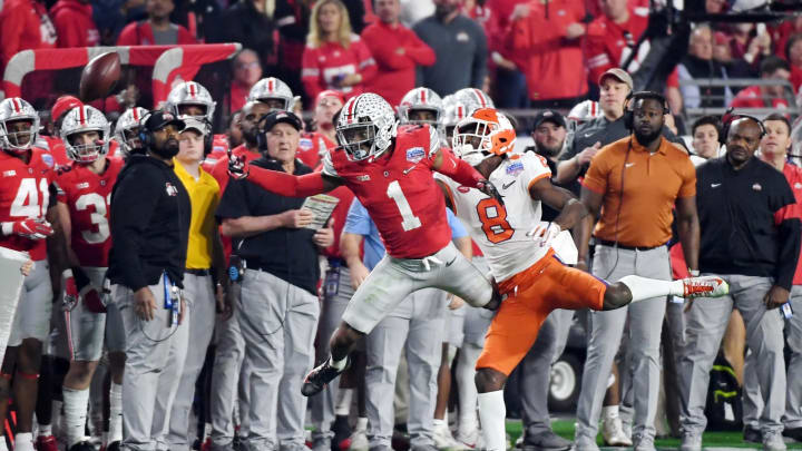GLENDALE, ARIZONA – DECEMBER 28: Jeff Okudah #1 of the Ohio State Buckeyes defends a pass to Justyn Ross #8 of the Clemson Tigers in the second half during the College Football Playoff Semifinal at the PlayStation Fiesta Bowl at State Farm Stadium on December 28, 2019, in Glendale, Arizona. (Photo by Norm Hall/Getty Images)