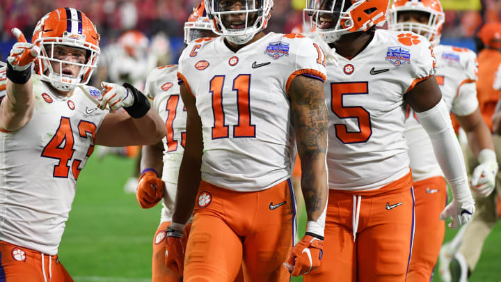 GLENDALE, ARIZONA – DECEMBER 28: Isaiah Simmons #11 of the Clemson Tigers is congratulated by his teammates after an interception against the Ohio State Buckeyes in the second half during the College Football Playoff Semifinal at the PlayStation Fiesta Bowl at State Farm Stadium on December 28, 2019, in Glendale, Arizona. (Photo by Norm Hall/Getty Images)
