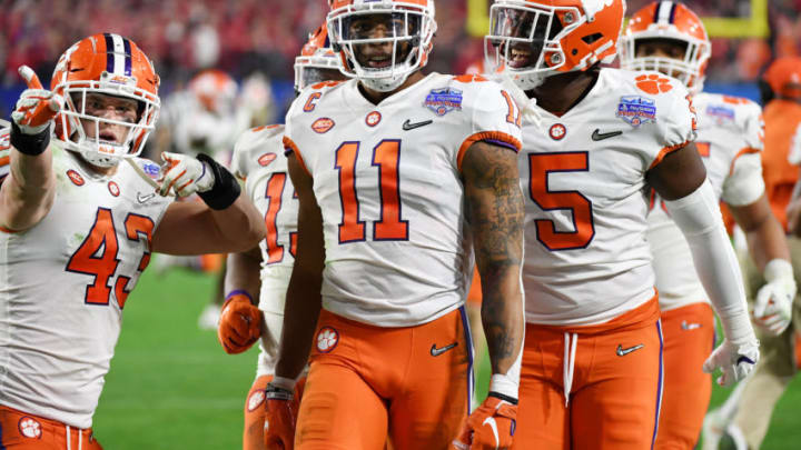 GLENDALE, ARIZONA - DECEMBER 28: Isaiah Simmons #11 of the Clemson Tigers is congratulated by his teammates after an interception against the Ohio State Buckeyes in the second half during the College Football Playoff Semifinal at the PlayStation Fiesta Bowl at State Farm Stadium on December 28, 2019 in Glendale, Arizona. (Photo by Norm Hall/Getty Images)