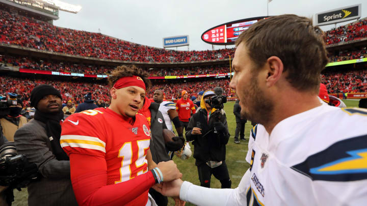 KANSAS CITY, MISSOURI – DECEMBER 29: Quarterback Patrick Mahomes #15 of the Kansas City Chiefs shakes hands with quarterback Philip Rivers #17 of the Los Angeles Chargers after the Chiefs defeated the Chargers 31-21 to win the game at Arrowhead Stadium on December 29, 2019, in Kansas City, Missouri. (Photo by Jamie Squire/Getty Images)