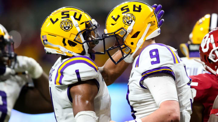 ATLANTA, GA - DECEMBER 28: Ja'Marr Chase #1 celebrates alongside Joe Burrow #9 of the LSU Tigers during the Chick-fil-A Peach Bowl against the Oklahoma Sooners at Mercedes-Benz Stadium on December 28, 2019 in Atlanta, Georgia. (Photo by Carmen Mandato/Getty Images)