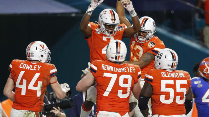 MIAMI, FLORIDA - DECEMBER 30: Joe Reed #2 and Terrell Jana #13 of the Virginia Cavaliers celebrate after a touchdown against the Florida Gators during the second half of the Capital One Orange Bowl at Hard Rock Stadium on December 30, 2019 in Miami, Florida. (Photo by Michael Reaves/Getty Images)