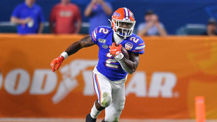 MIAMI, FLORIDA - DECEMBER 30: Lamical Perine #2 of the Florida Gators runs with the ball in the second half the Capital One Orange Bowl against the at Hard Rock Stadium on December 30, 2019 in Miami, Florida. (Photo by Mark Brown/Getty Images)
