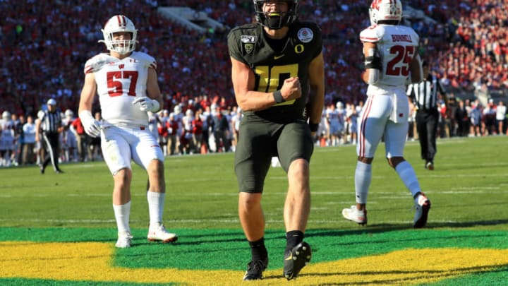 PASADENA, CALIFORNIA - JANUARY 01: Justin Herbert #10 of the Oregon Ducks celebrates after scoring a four yard touchdown against the Wisconsin Badgers during the first quarter in the Rose Bowl game presented by Northwestern Mutual at Rose Bowl on January 01, 2020 in Pasadena, California. (Photo by Sean M. Haffey/Getty Images)