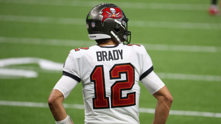 NEW ORLEANS, LOUISIANA - SEPTEMBER 13: Tom Brady #12 of the Tampa Bay Buccaneers warms up before the start of a game against the New Orleans Saints at Mercedes-Benz Superdome on September 13, 2020 in New Orleans, Louisiana. (Photo by Chris Graythen/Getty Images)